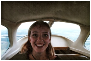Me in the back of the four-seater plane - note the slightly panicked expression.